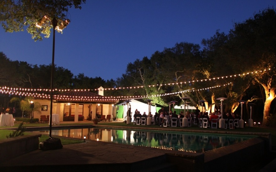 Poolside Wedding Reception with String Lights